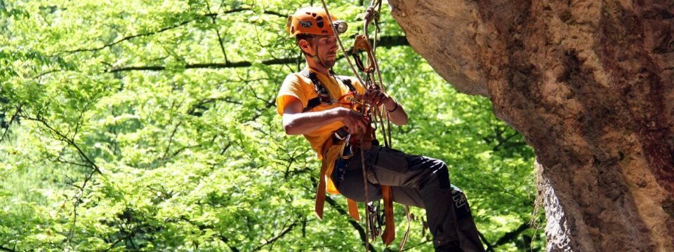 Abseiling or rappelling